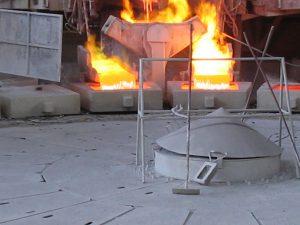 Molten copper pouring into anode mold.