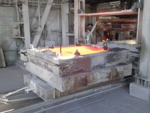 Molten copper in a refractory lined mold.